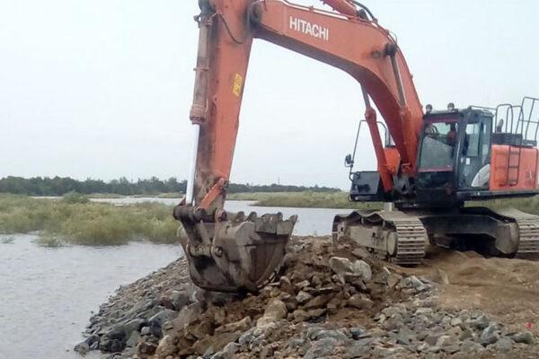 Устройство укрепления откосов камнем  технологической площадки опоры №22